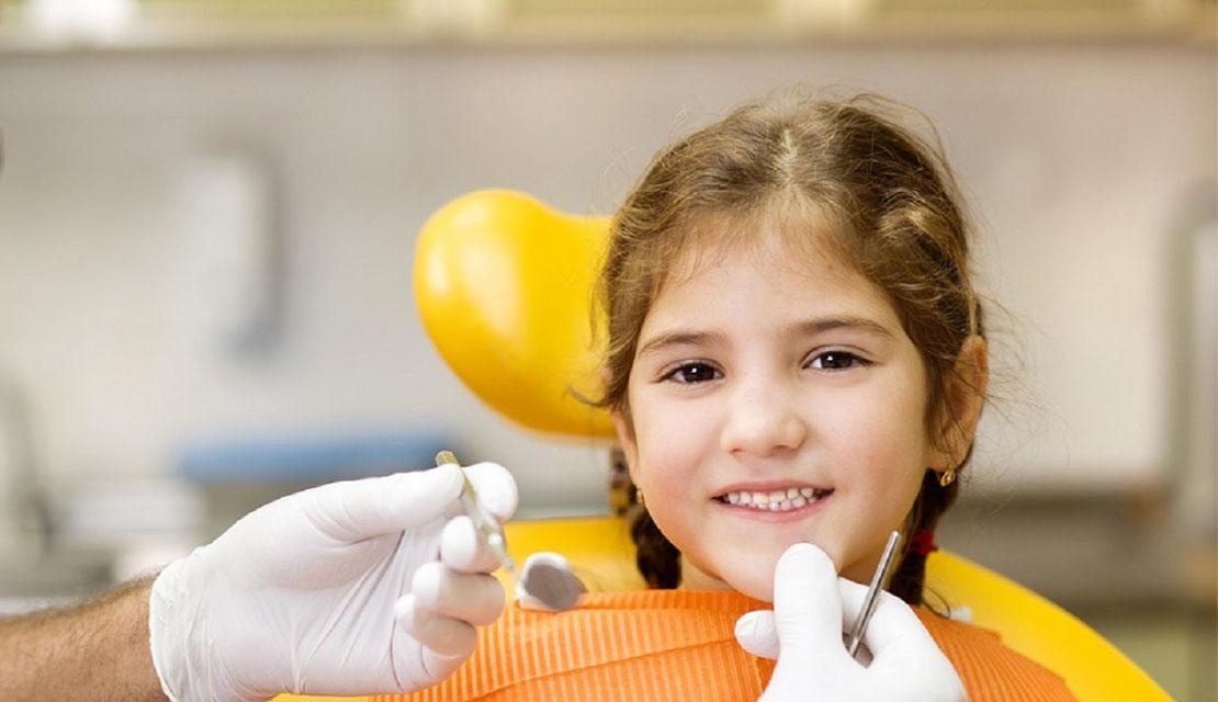 Highland Creek Dental - Scarborough Dentist - Dr. S. Razmavar - young girl getting a checkup